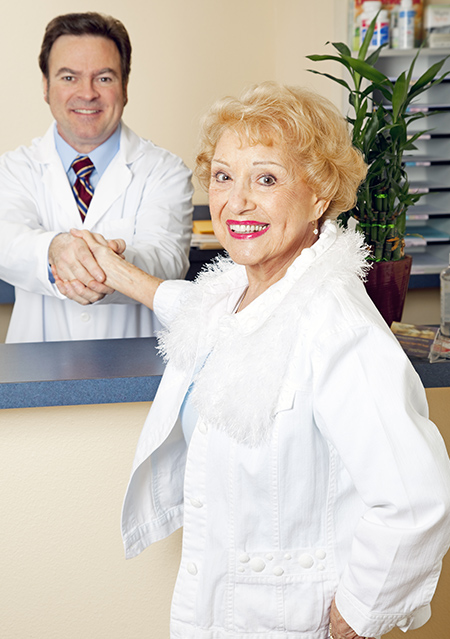 Chiropractor greeting a new patient
