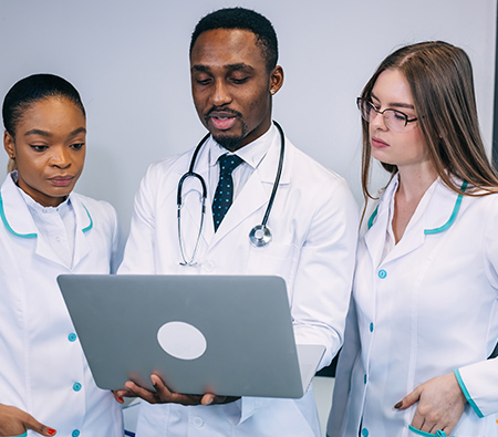 doctor and team creating report of findings